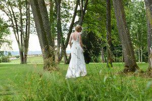 "Bride wearing her ""Juste un baiser"" lace dress at the Domaine de Boissy. Boho, vintage, bucolic wedding. Photo by Anais Chaine."