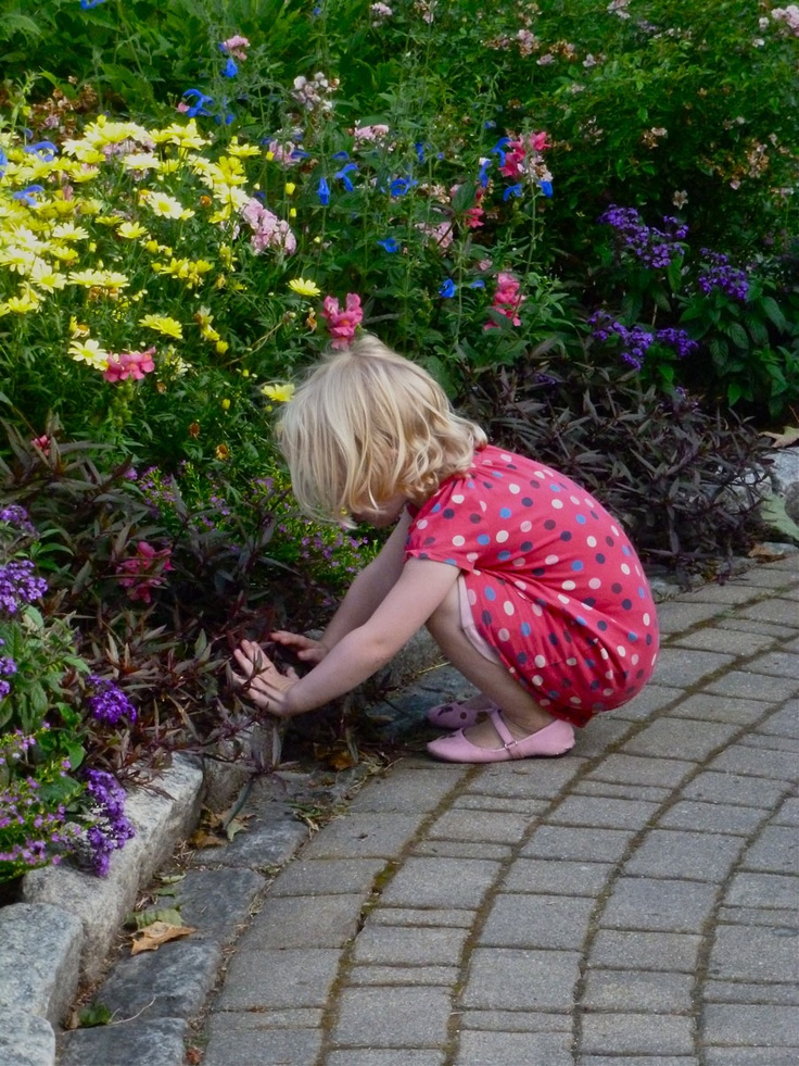 This little girl was watering the flowers with her hands, getting water from a nearby fountain. Back and forth she went for about ten minutes.