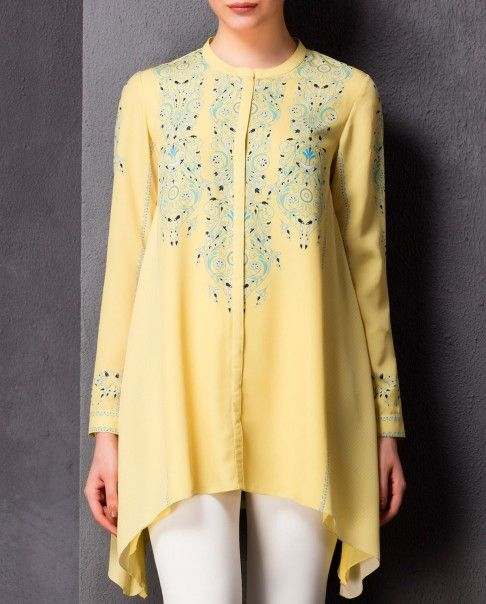 Buttercream yellow full sleeves tunic with blue printed accent. Round neckline. Asymmetric hem.Wash care: Dry clean onlyPants worn by the model are only for styling purpose
