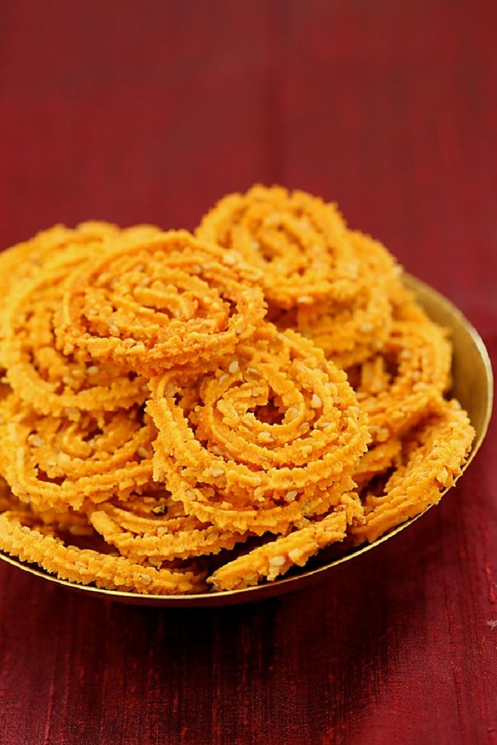 Gluten-free Rice Flour Spirals With Sesame Seeds 240 gm (1 1/2 cups) rice flour  65 gm (1/2 cup) split roasted gram (dalia or phutana), powdered in a blender  1/8 tsp baking soda  1 tsp red chilli powder  1 1/4 tsp salt  1/4 tsp hing or asafetida  40 gm (1/4 cup) sesame seeds  2 tbsp oil, heated until hot but not smoking  175 ml (3/4 cup) water