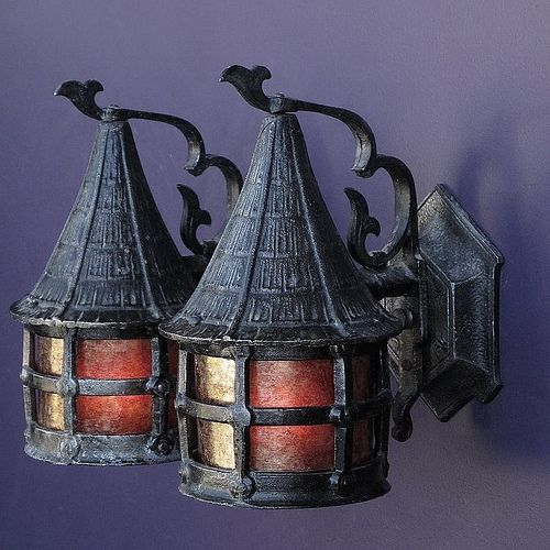 "Storybook style vintage porch light with a ""Witches Hat"" top. Perfect size antique lamp to welcome someone up the winding path to the cottage door. Nicely refinished to match an original oil rubbed bronze color finish. Refitted with a new mica shade. Great looking vintage lighting fixture for any Lodge, Bungalow, Tudor, Cottage or Storybook home.   http://www.vintagelights.com/product/1/vintage-lodge-or-cottage-size-storybook-porch-light-fixture-2-pairs-available-priced-per-pair.html"