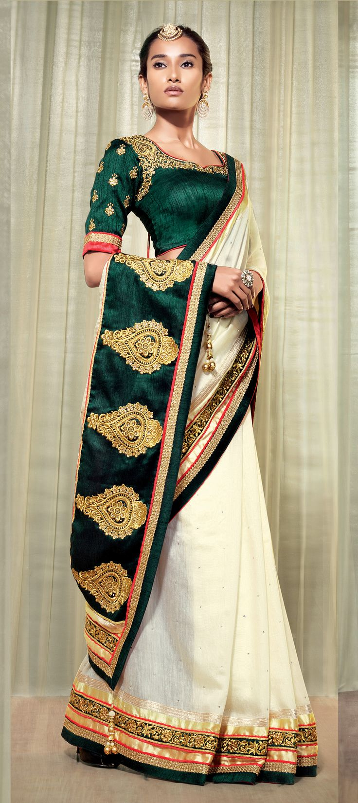 Green and off white color silk saree with blouse. Royal Indian bride style.