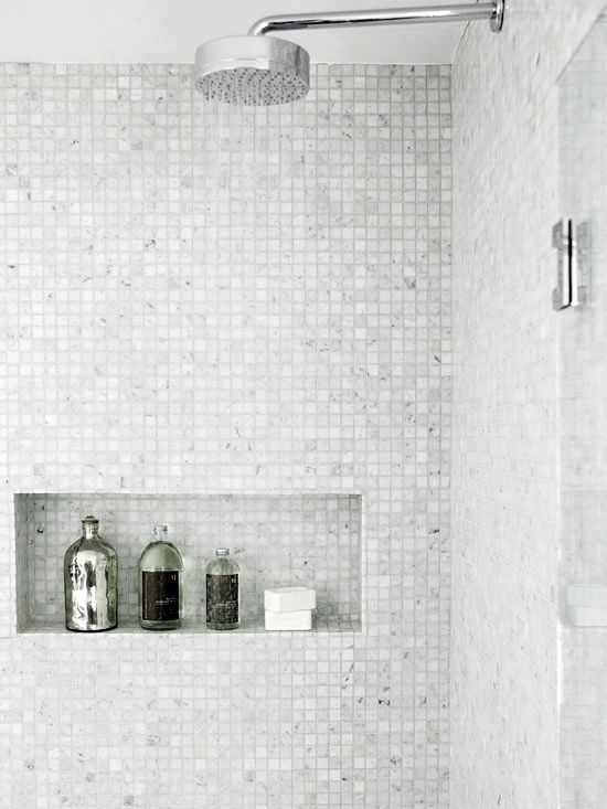 Modern shower. Small tiles that look like they sparkle. Like the tile cut out and overhead shower head.