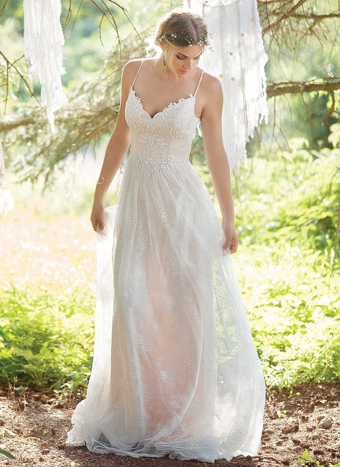 Chantilly embroidered lace spaghetti strap A-line gown featuring a front and back V-neckline and natural waistline. The lightweight charmeuse lining of this gown creates a soft, organic feeling. https://www.lillianwest.com/lillian_west/6395