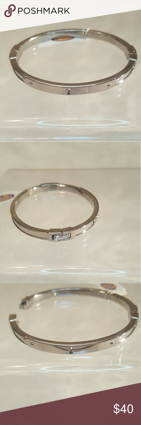 """🎁 Fossil Silver """"Lock"""" Bangle Bracelet Fossil Bangle Bracelet has the iconic """"lock"""" detail and two rivets on the front.  Bracelet has push clasp opening and hindge. Very sturdy closure.  Silver color, made of stainless steel. ▫ New with tags ▫ Made in China  Stack with the other fossil bangle listed for a complete look!  🎁 Gift? Will come in gift box. Free gift Bracelet has push clasp opening and hindge. Very sturdy closure. if you ask! (Will take tags off for gift wrap) Fossil Jewelry…"""