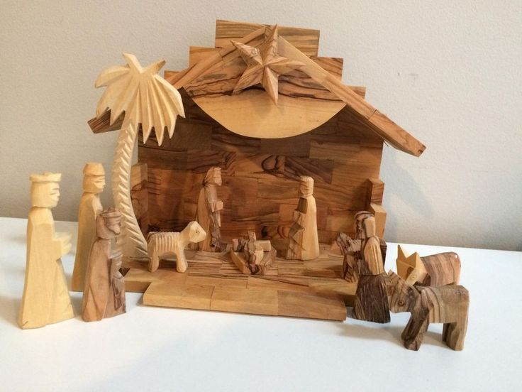 "12 piece nativity set made of pruned olive tree branches dried for a year and then cut into mosaic like blocks. The star on the front of the nativity can be wound to play "" Silent Night "". Handcrafted and carved at a 133 year old family owned studio in Bethlehem. 
