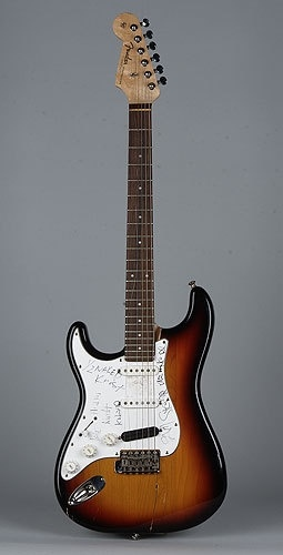 This is Kurt Cobain's Sunburst Stratocaster that he played at Nirvana's legendary Reading Festival gig in 1992.  He later smashed the guitar in Florida at a show on November 26th, 1993.