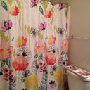 A garden-inspired motif gives this vibrant shower curtain a pop of eye-catching appeal. Add it to the master bath or powder room to liven up an all-white ensemble or pair it with colorful bath mats and towels to embrace a bright design.