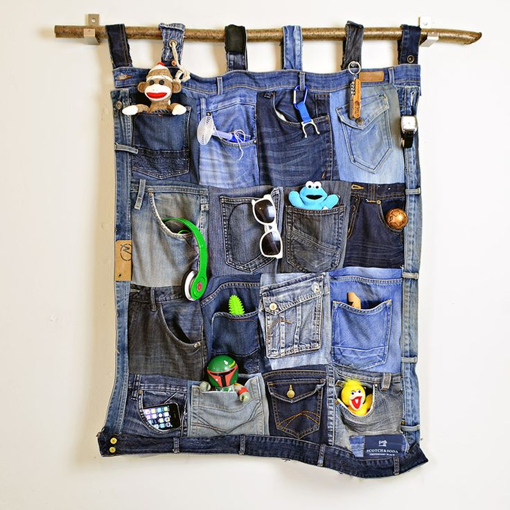 Denim Wall Oraganiser . Make this fantastic wall organiser by using the pockets of old Jeans. Would look great in a teen bedroom or home office. Full tutorial Pillarboxblue
