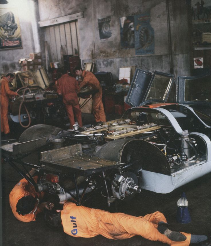 Hard life of the mechanics. Uncomfortable and arduous reality of preparing a racing car in a period garage at Le Mans 1970. (Paul...