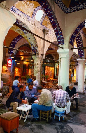 Tea drinkers sit around a table at the Old Bazaar - Istanbul, Turkey