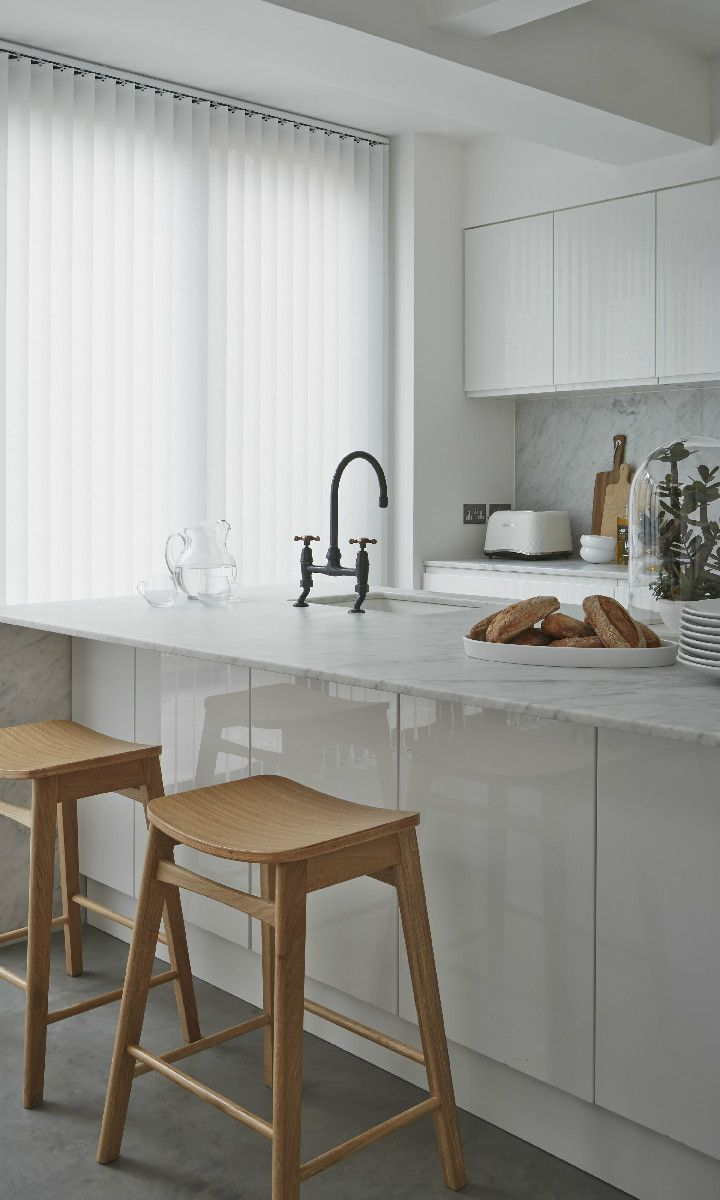 Create a sleek scandi look with bright whites, hints of wood and marble in accessories and cabinets. Made to measure vertical blinds in Amla White are perfect for this look and it would look fantastic in bathrooms and kitchens.