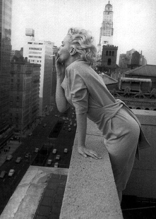 Marilyn Monroe having a smoke outside in New York City, 1950s.