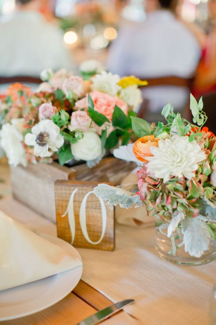 Rustic + Colorful Centerpiece - See more of the wedding on SMP: http://www.StyleMePretty.com/southeast-weddings/2014/03/05/colorful-southern-wedding-in-palmetto-georgia/ Harwell Photography