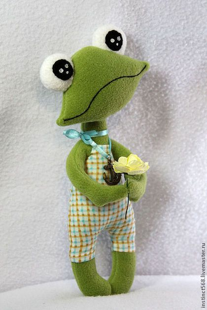 VERY CUTE FROG WITH FLOWER.