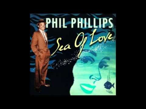 """""""Sea of Love"""" is a song written by John Phillip Baptiste (aka Phil Phillips) and George Khoury. Phillips' 1959 recording of the song peaked at #1 on the U.S...."""