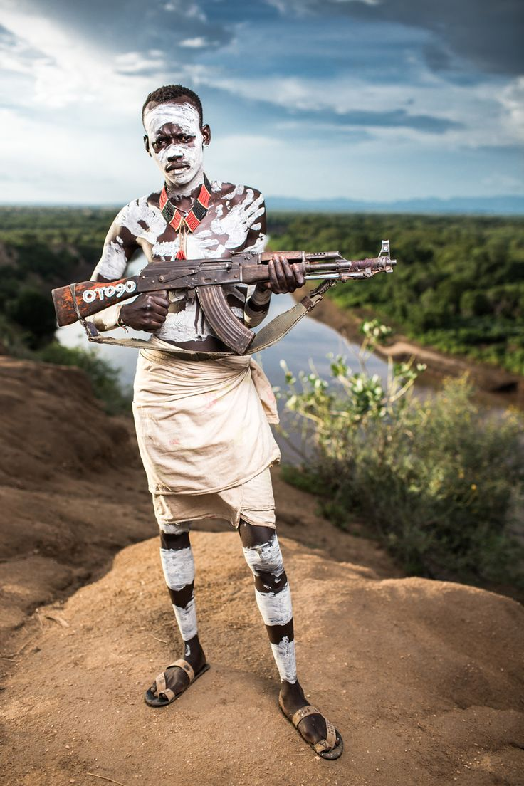 Karo soldier holding an AK-47 Assault Riffle defending his Village in Ancho Village by the famous omo river in east Ethiopia next to south sudan border.:
