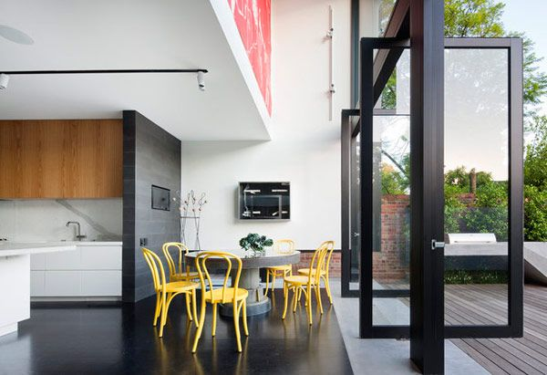 Love the inside/outside non-boundary and contrast with traditional front of home Nixon Tulloch Fortey modern remodel addition via @Tyler Goodro