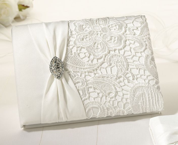 Vintage lace guestbook by All About Weddings