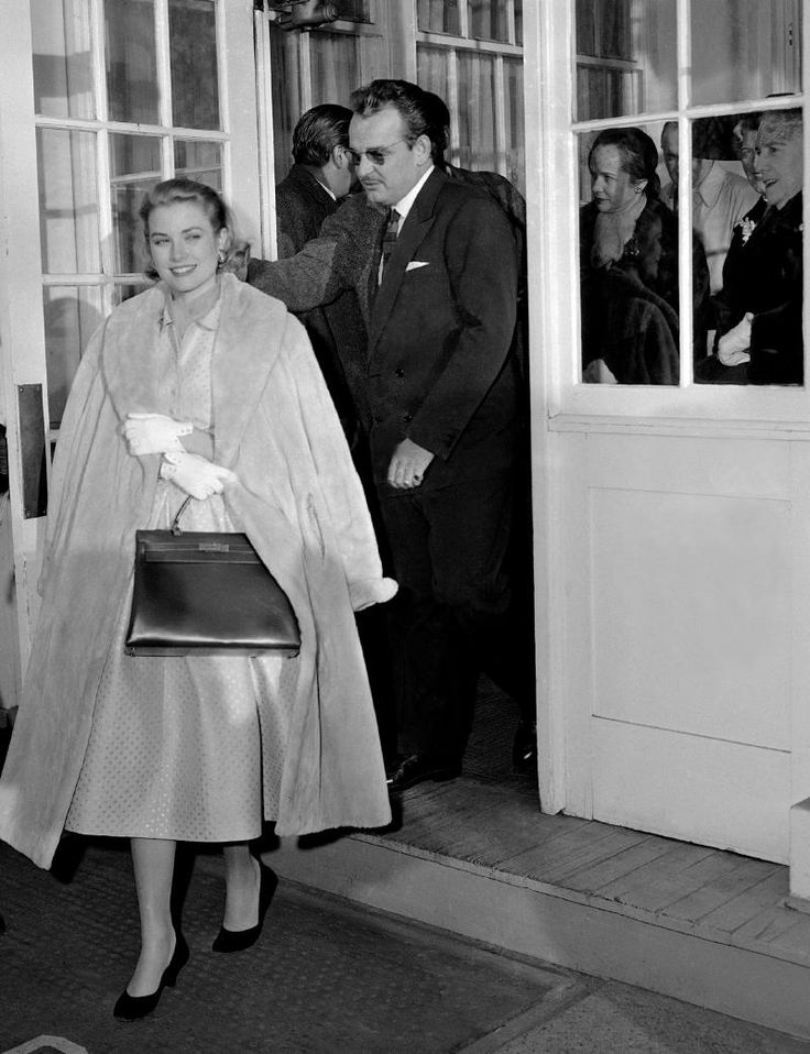 January 5, 1956 Grace Kelly With Prince Rainier III of Monaco leaving their engagement luncheon party in Philadelphia, Pennsylvania.