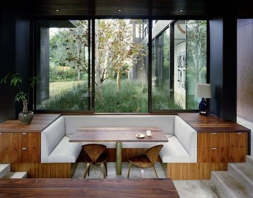 love this sunken table and those big windows