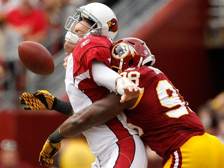 Arizona Cardinals quarterback Kevin Kolb, left, is sacked by Washington Redskins outside linebacker Brian Orakpo in the first half of in Landover, Md., Sunday, Sept. 18.