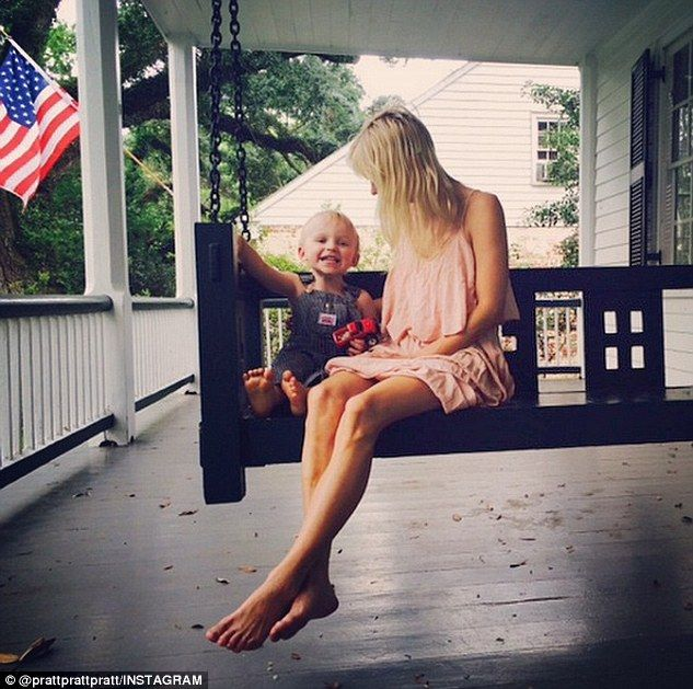 One happy boy! Chris shared this image of his son Jack and wife Anna Faris on Sunday, which read, 'Happy boy, happy wife, happy life, porch swing. #CanIGetAHashtag'