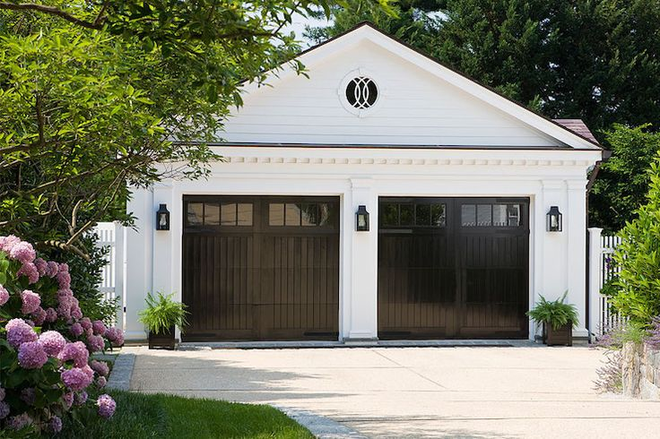 Anne Decker Architects - garages - his and her garages, black garage doors,  His and her garages with glossy black doors.