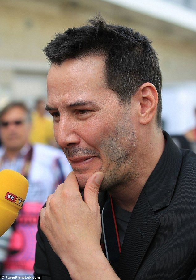 2014 3rd November  'Let me Think'  Keanu Reeves at the Grand Prix in Texas. wearing black blazer and grey graphic T-Shirt. dailymail.co.uk