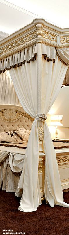 opulent ivory bed canopy in antique gold bedding and