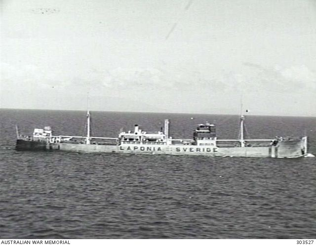 1941-09-20. STARBOARD SIDE VIEW OF THE SWEDISH CARGO VESSEL MV LAPONIA. NOTE THE SHIP'S NAME, NATIONALITY AND FLAG DISPLAYED PROMINENTLY ON THE SHIP'S SIDE, INDICATING HER NEUTRALITY. (NAVAL ...