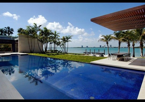 3 Indian Creek Miami, Florida - The infinity-edge swimming pool is fitted with underwater speakers. The beach beyond is comprised of pink sand imported from the Bahamas.