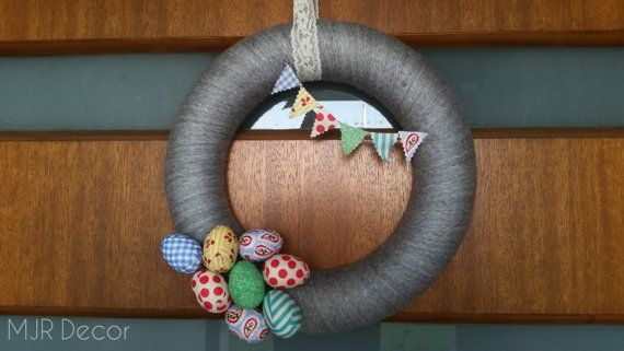 Light grey Easter wreath with bunting and Easter eggs by MJRDecor