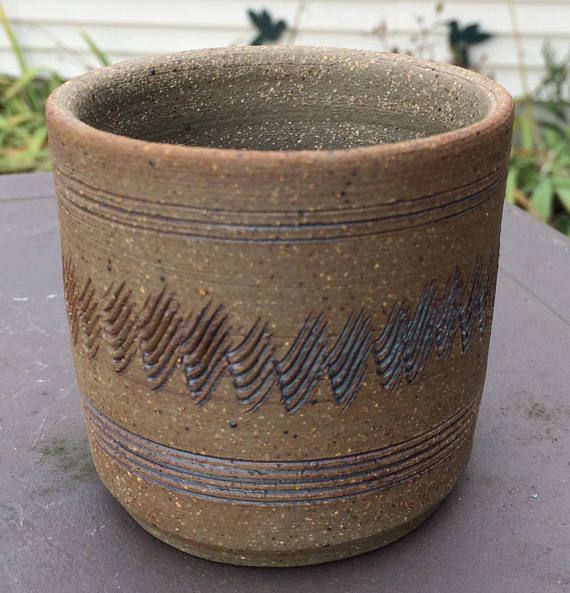 $10 for sale 2018 This is a handmade, stoneware cup or tumbler.  It is hand thrown on a potters wheel and unglazed.  It measures about 3 tall and 3 wide and holds up to approximately 8 oz.  This cup is microwave, oven, dishwasher and food safe.  Would also make a great toothbrush holder or pencil