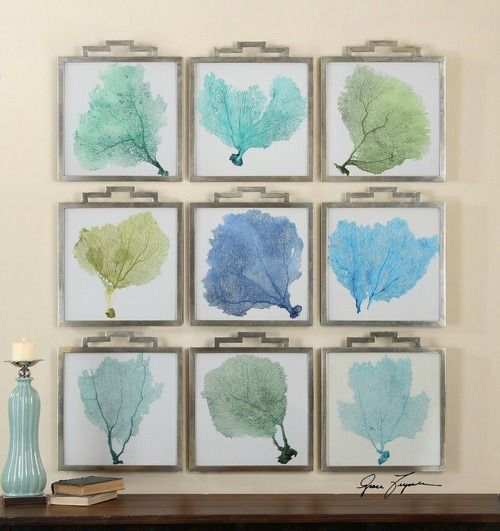 Fabulous coastal wall art! Nine separate prints of pastel blue and green sea fans, accented by narrow frames with a plated, oxidized silver finish and a gray wash.