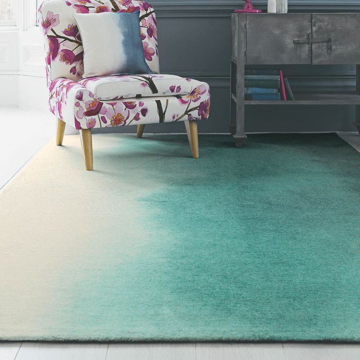Paintbox rugs feature a teal colour wash design which appears to flow from one side to the other in a beautiful ombre, painterly wash. #Rugs #InteriorDesign