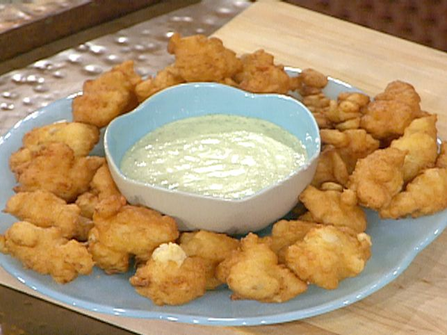 Caribbean Conch Fritters with Cilantro Tartar Sauce Recipe : Emeril Lagasse .. Dont have conch available here .. could sub in chicken or shrimp or fish.