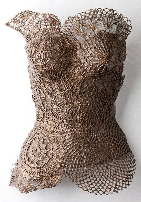 Crocheted doilies on form