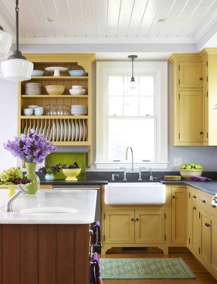 A Kitchen With Yellow Cabinets And Gray Walls Like Ours