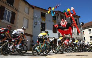 Didi 'The Devil' Senft jumps in the air as the riders set off from Moirans-en-Montagne.