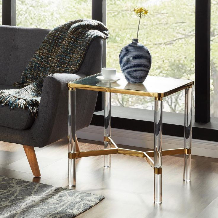 Even small spaces feel airy with the right home accents. Take the Morelia sidetable with gold framing and clear acrylic legs from !snpire. Perfect!     http://worldwidehomefurnishingsinc.com/morelia-accent-table-in-gold.html