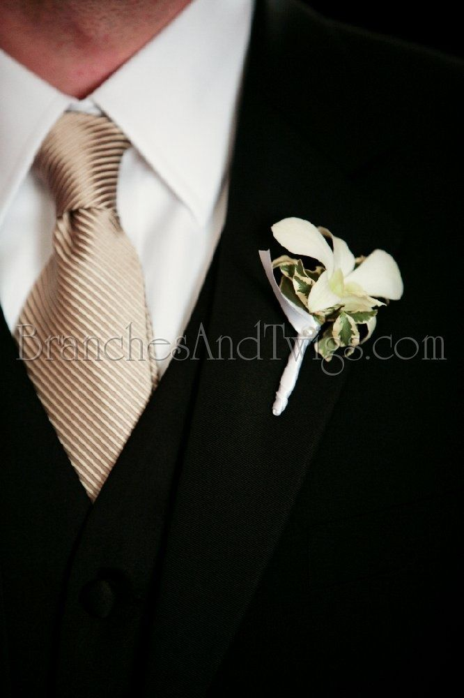 Elegant gold neck tie with white floral boutonniere for the groom and his men