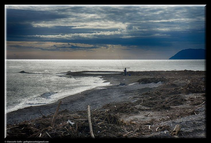 Lonely fisherman by Giancarlo Gallo