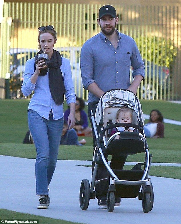 Family fun: Emily Blunt and husband John Krasinski enjoyed a casual stroll with daughter H...
