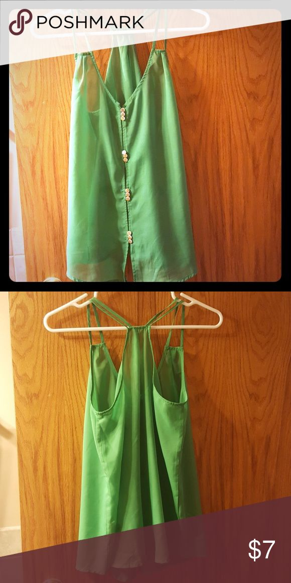 Sassy green tank Pearled buttons with gold crowns. Spice up your outfit with this emerald number. A bit sheer, I paired with a nude bandeau.  *🔥* Lime earrings and ring are also available in my closet - BUNDLE! Tops Tank Tops