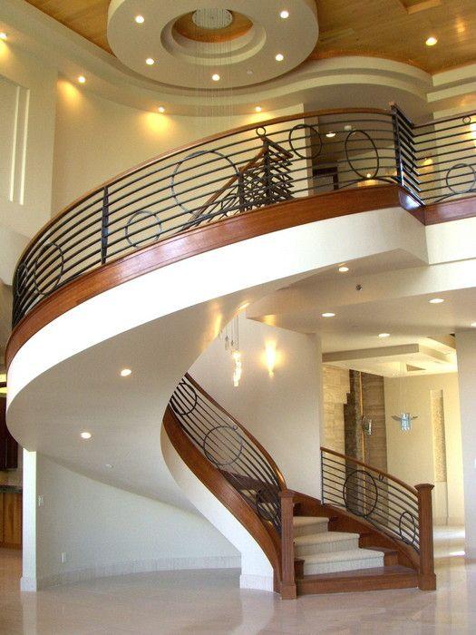 White plaster, wood edge, art deco wrought iron staircase