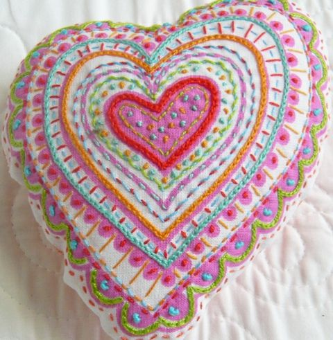 an embroidered heart....sew whimsical, i sew want one, too! the blend of colors and stitches are very pleasing to my eyes...