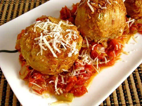 "Arancini di Riso: ""Rice Balls"" (* leftover risotto, * mozzarella cheese cut into cubes, 1 egg (lightly beaten), 1/4 cup parmigiano reggiano (grated), 1 cup bread crumbs, vegetable oil for frying, and * leftover marinara sauce)"