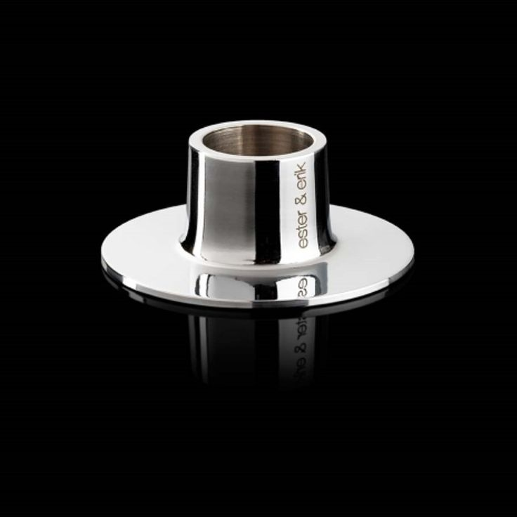 Stunning Chrome single candle holder, pure Danish design by Ester & Erik. Great alone or in a group, these work well if you have small spaces & you can put decorations around the base too. Goegeous.