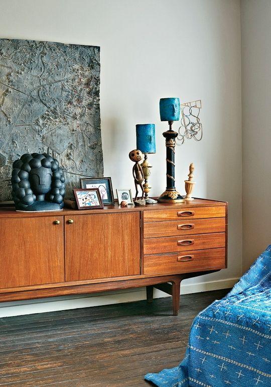 An exquisite mid-century credenza,  bright hits of mid-century peacock blue, gorgeous vignettes at staggered heights